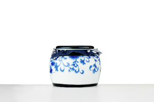 Tall Tea Caddy With Picture Of Butterflies Sitting On Flowers
